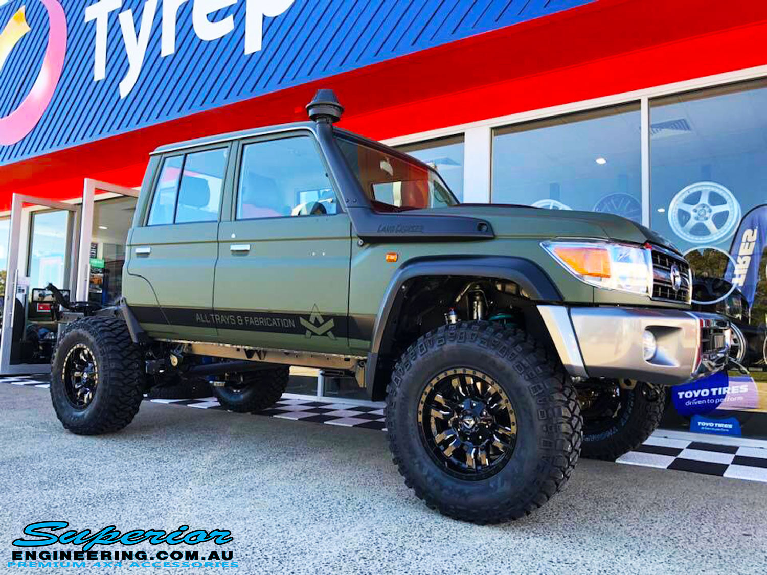 "Right front side view of a Green Toyota 79 Series Landcruiser Dual Cab after fitment of a Superior 4"" Inch Remote Reservoir Superflex Lift Kit"
