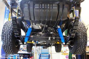 "Rear middle underbody shot of the fitted Superior 4"" Inch Remote Reservoir Shocks + Mounts & Leaf Springs with U-Bolt Kit & Shackles"