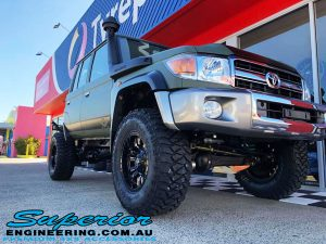 "Close up right front view of a Green Toyota 79 Series Landcruiser Dual Cab after fitment of a Superior 4"" Inch Remote Reservoir Superflex Lift Kit"