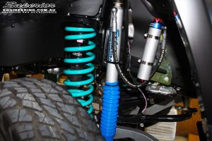 """Front right inside guard view of the fitted 4"""" Inch Superior Engineering Remote Reservoir Adjustable Front Shocks + Coil Springs"""