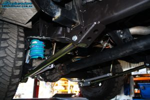 Mid rear right outside view of the fitted Superior Lower Control Arm, Sway Bar Kit & Airbag Man Coil Air Helper Kit with Coil Spring