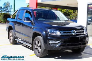 Right front side view of a Black Volkswagen Amarok Dual Cab being fitted with a wide range of quality 4x4 Suspension and Accessories