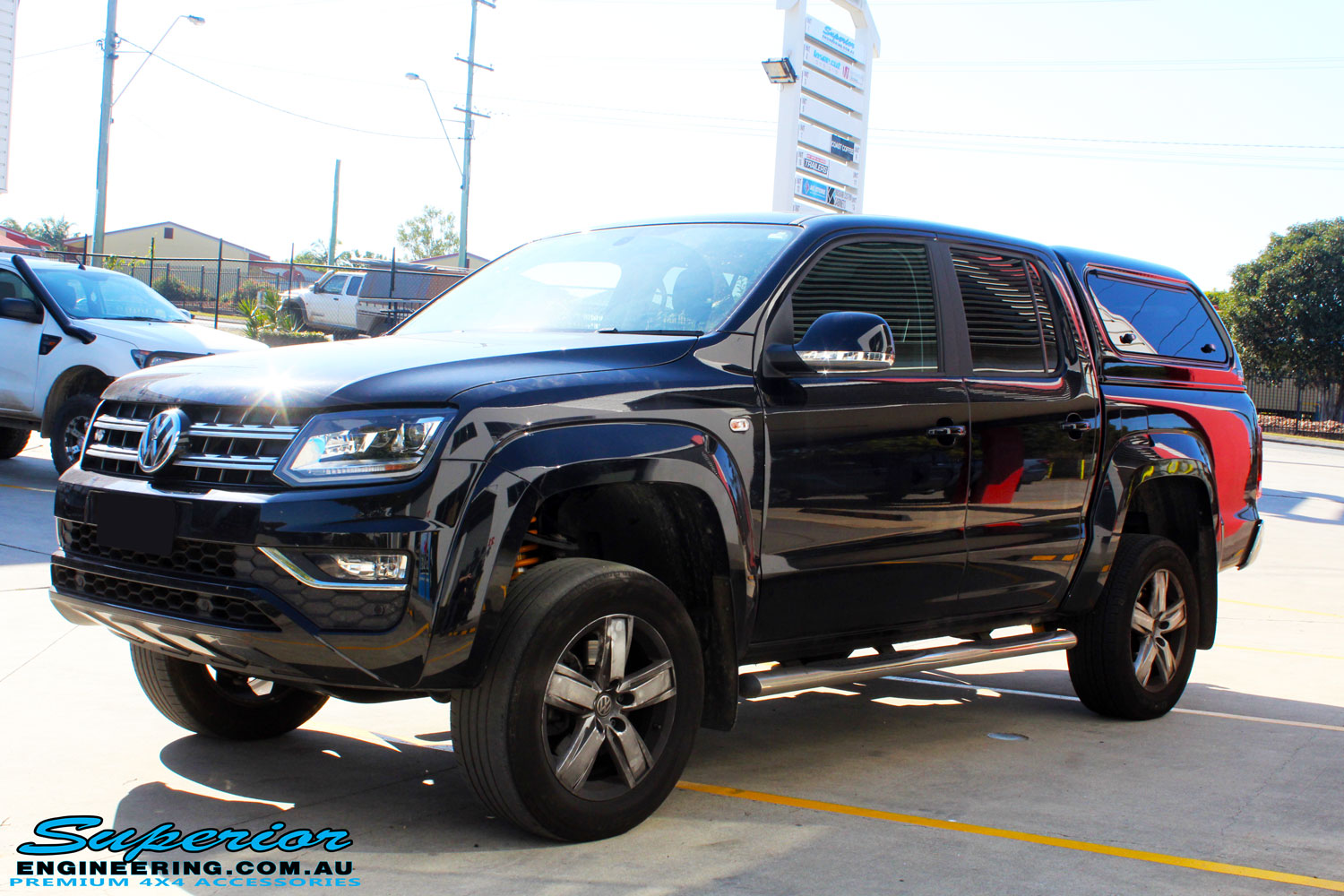 Left front side view of a Black Volkswagen Amarok Dual Cab after being fitted with a wide range of quality 4x4 Suspension and Accessories