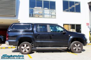 Left side view of a Black Volkswagen Amarok Dual Cab after being fitted with a wide range of quality 4x4 Suspension and Accessories