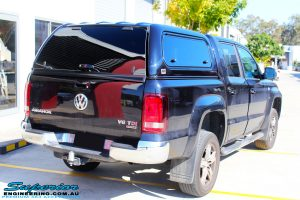 Rear left view of a Black Volkswagen Amarok Dual Cab after being fitted with a wide range of quality 4x4 Suspension and Accessories