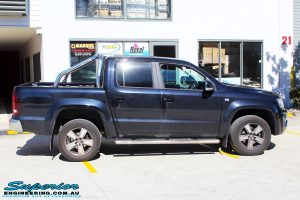 Right side view of a Black Volkswagen Amarok Dual Cab being fitted with a wide range of quality 4x4 Suspension and Accessories
