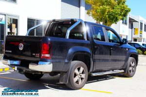 Rear right view of a Black Volkswagen Amarok Dual Cab being fitted with a wide range of quality 4x4 Suspension and Accessories