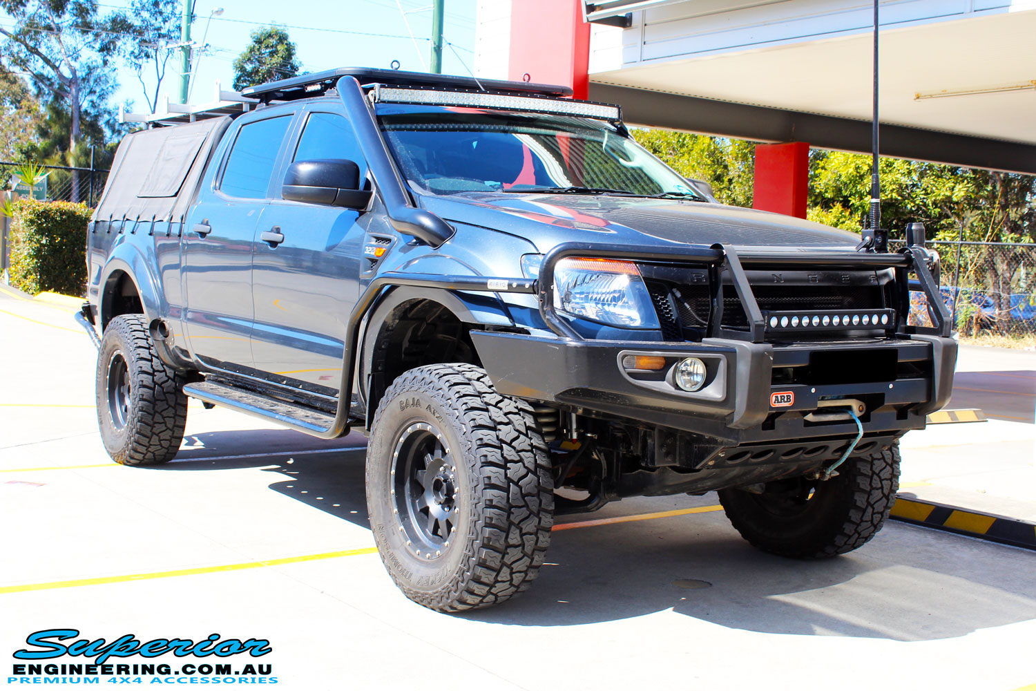 "Right front side view of a Blue Ford PX Ranger Dual Cab fitted with Superior 3"" Inch Adjustable Monotube Remote Reservoirs & Coil Springs"