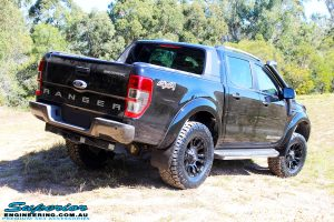 """Rear right outside view of a Ford PXII Ranger in Black flexing up after fitment of a Superior 3"""" Inch Remote Reservoir Lift Kit, Rhino 4x4 Winch Bar, VRS Winch, GME UHF CB & Antenna, Nitto Ridge Grappler Tyres & Fuel Vaper Matte Black Wheels"""