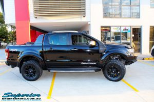 """Right side view of a Ford PXII Ranger in Black flexing up after fitment of a Superior 3"""" Inch Remote Reservoir Lift Kit, Rhino 4x4 Winch Bar, VRS Winch, GME UHF CB & Antenna, Nitto Ridge Grappler Tyres & Fuel Vaper Matte Black Wheels"""