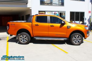 """Right side shot of a Orange Ford PXII Ranger Dual Cab before fitment with a Rhino 4x4 Evolution 3D Winch Bar & Legendex 409 Stainless Steel 3"""" Inch Exhaust + Power Command Module"""