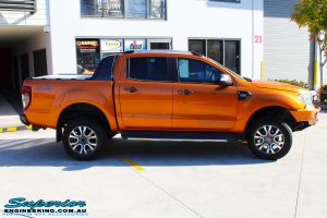 """Right side shot of a Orange Ford PXII Ranger Dual Cab after fitment with a Rhino 4x4 Evolution 3D Winch Bar & Legendex 409 Stainless Steel 3"""" Inch Exhaust + Power Command Module"""