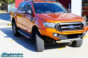 """Front on right view of a Orange Ford PXII Ranger Dual Cab after fitment with a Rhino 4x4 Evolution 3D Winch Bar & Legendex 409 Stainless Steel 3"""" Inch Exhaust + Power Command Module"""