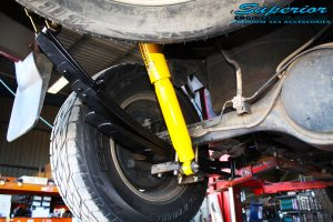 Rear left shot looking at the fitted Dobinson Rear Shock + Leaf Spring