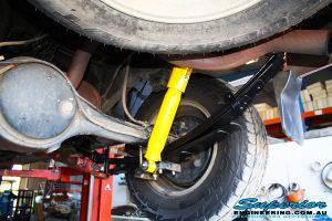 Rear right shot looking at the fitted Dobinson Rear Shock + Leaf Spring