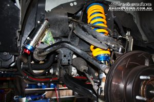 Front left inside guard view of the fitted Superior Adjustable Remote Reservoir Strut + Coil Spring