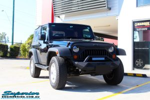 Right front side view of a Black Jeep JK SWB before fitment of a Dobinson 50mm Lift Kit