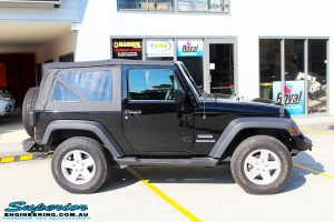 Right side view of a Black Jeep JK SWB before fitment of a Dobinson 50mm Lift Kit