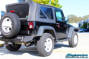 Rear right side view of a Black Jeep JK SWB before fitment of a Dobinson 50mm Lift Kit