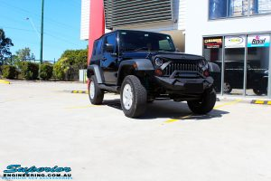 Right front side view of a Black Jeep JK SWB after fitment of a Dobinson 50mm Lift Kit