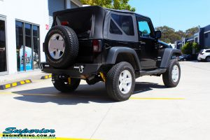 Rear right side view of a Black Jeep JK SWB after fitment of a Dobinson 50mm Lift Kit