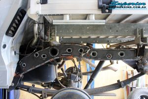 Rear right view of the Superior Chassis Brace being prepped for fitment