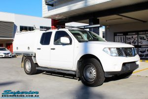 """Right front side view of a Nissan D40 Navara Dual Cab before fitment of a Superior Nitro Gas 2"""" Inch Lift Kit"""