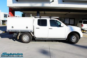 """Right side view of a Nissan D40 Navara Dual Cab before fitment of a Superior Nitro Gas 2"""" Inch Lift Kit"""