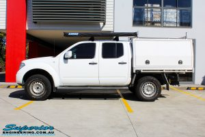 """Left side view of a Nissan D40 Navara Dual Cab after fitment of a Superior Nitro Gas 2"""" Inch Lift Kit"""