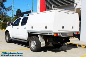 """Rear left view of a Nissan D40 Navara Dual Cab after fitment of a Superior Nitro Gas 2"""" Inch Lift Kit"""