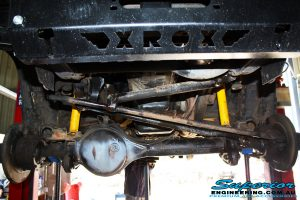 """Front underbody shot of the front suspension components before fitment of the new Superior 3"""" Inch Lift Kit"""