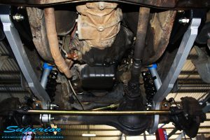 """Underbody reverse shot of the front fitted Superior 3""""Inch Hybrid Superflex Arms, Superior Nitro Gas 2"""" Inch Shocks + Coil Springs & Superior 4340m Comp Spec Tie Rod"""