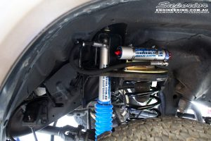 Front left inside guard shot of the fitted Adjustable Monotube Remote Reservoir Shock, Front Remote Reservoir Mounts and Coil Spring