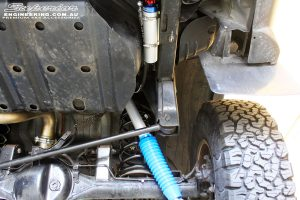 Rear right underbody view of the fitted Superior Adjustable Monotube Remote Reservoir Shock, Front Remote Reservoir Mounts and Coil Spring