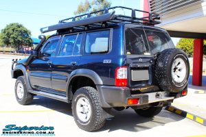 """Rear right side view of a Nissan GU Patrol Wagon after fitment of a Superior Remote Reservoir 2"""" Inch Lift Kit"""