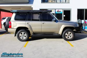 Right side view of a Nissan GU Patrol Wagon in Gold On The Hoist @ Superior Engineering Deception Bay Showroom
