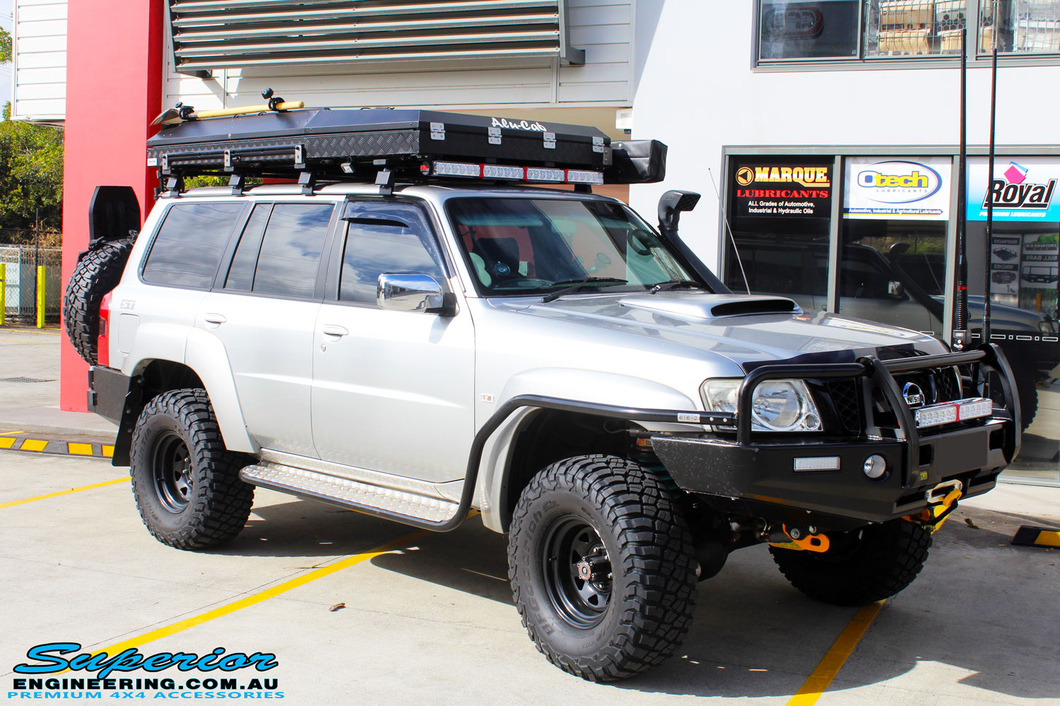 Front right side view of the Nissan GU Patrol Wagon before fitment of a Airbag Man Coil Air Kit & Superior Drop Out Cones