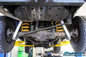 Centre rear underbody view of the fitted Tough Dog Rear Shocks & Coil Springs