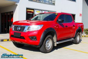 "Left front side view of a Red Nissan NP300 Navara Dual Cab before fitment of a Superior Remote Reservoir 3"" Inch Lift Kit"