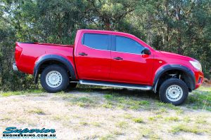 """Right side view of a Red Nissan NP300 Navara Dual Cab after fitment of a Superior Remote Reservoir 3"""" Inch Lift Kit"""