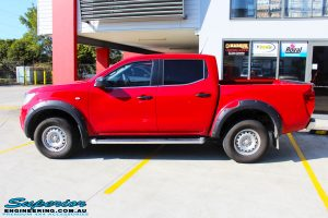 """Left side view of a Red Nissan NP300 Navara Dual Cab before fitment of a Superior Remote Reservoir 3"""" Inch Lift Kit"""