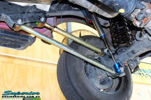 """Rear right underbody shot of the fitted Superior Lower & Upper Control Arms with 3"""" Inch Remote Reservoir Rear Shock & Coil Spring"""