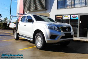"""Right front side view of a Silver Nissan NP300 Navara Dual Cab before fitment of a Superior Remote Reservoir 2 Inch Lift Kit & Airbag Man Coil Air Kit 2"""" Inch Lift"""