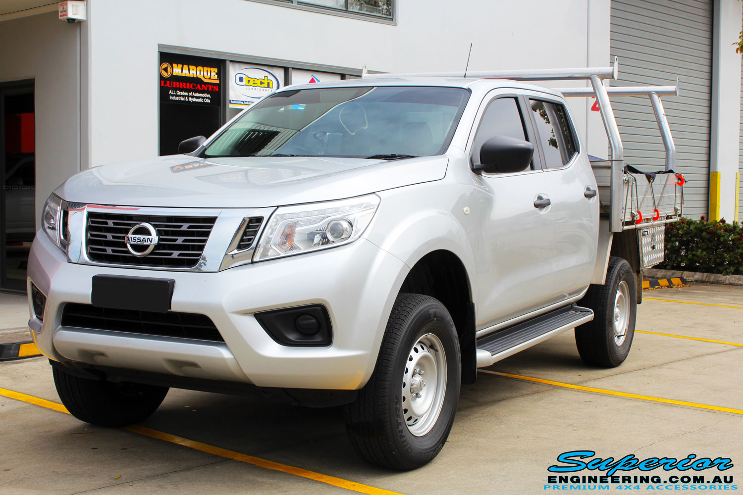 "Left front side view of a Silver Nissan NP300 Navara Dual Cab after fitment of a Superior Remote Reservoir 2 Inch Lift Kit & Airbag Man Coil Air Kit 2"" Inch Lift"