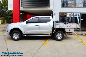 """Left side view of a Silver Nissan NP300 Navara Dual Cab after fitment of a Superior Remote Reservoir 2 Inch Lift Kit & Airbag Man Coil Air Kit 2"""" Inch Lift"""