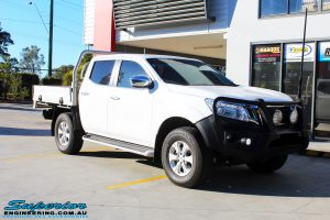 """Right front side view of a White Nissan NP300 Navara Dual Cab before fitment of a 2"""" Inch Lift Kit"""