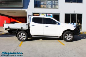 """Right side view of a White Nissan NP300 Navara Dual Cab before fitment of a 2"""" Inch Lift Kit"""