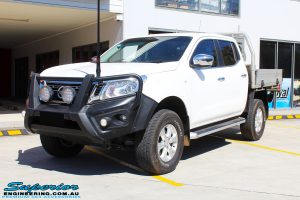 "Left front side view of a White Nissan NP300 Navara Dual Cab after fitment of a 2"" Inch Lift Kit"