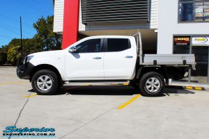 """Left side view of a White Nissan NP300 Navara Dual Cab after fitment of a 2"""" Inch Lift Kit"""