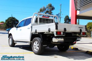 """Rear left side view of a White Nissan NP300 Navara Dual Cab after fitment of a 2"""" Inch Lift Kit"""